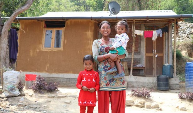 Niru & her family outside their new Habitat home